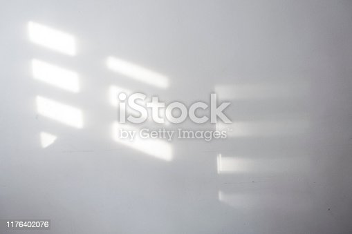 shadow on wall from wooden blind