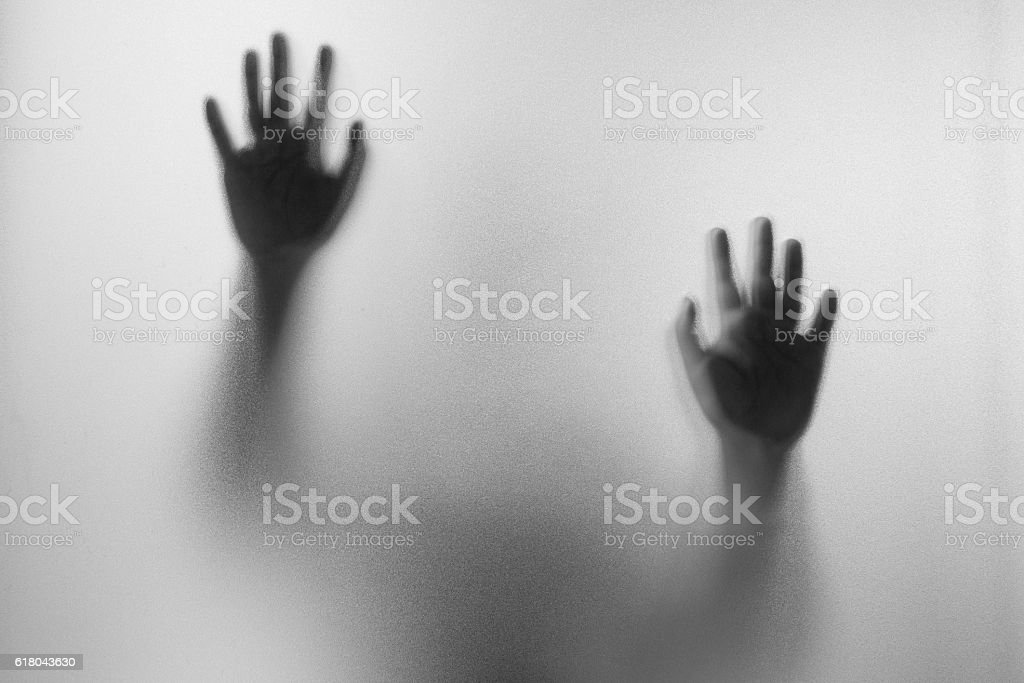 Shadow hands of the Man behind frosted glass. - foto de acervo