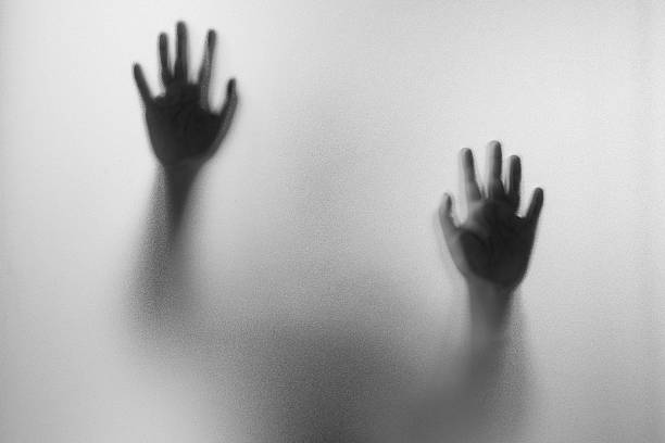 Shadow hands of the Man behind frosted glass. – Foto
