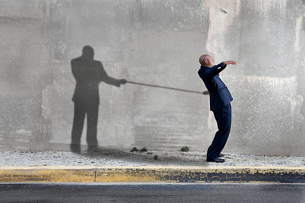 Shadow holding man back  low self esteem stock pictures, royalty-free photos & images
