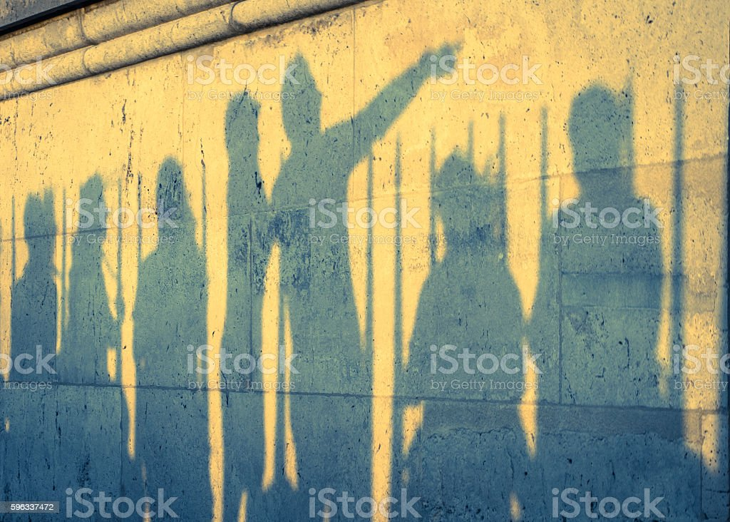 Shadow of 7 people (cross process) royalty-free stock photo