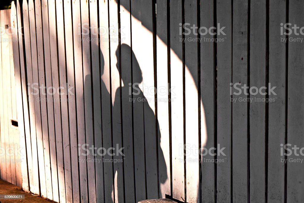 shadow of a boy with mother stock photo