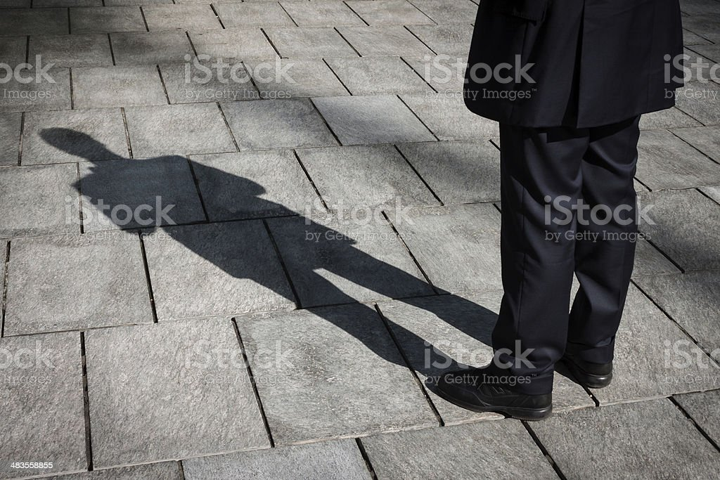 Shadow of a businessman standing stock photo