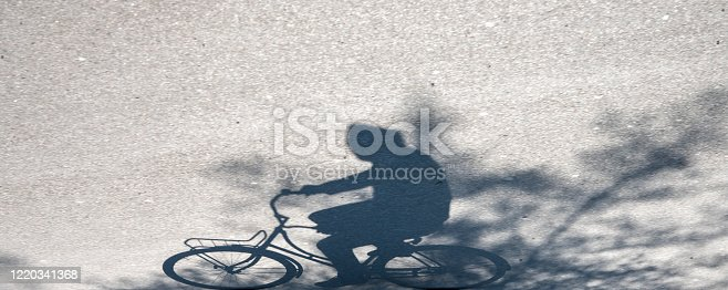 812812808 istock photo Shadow of a cyclist 1220341368