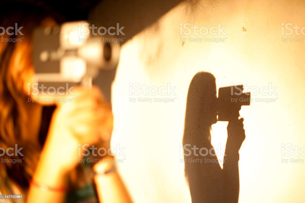 Shadow of a girl holding a vintage camera royalty-free stock photo