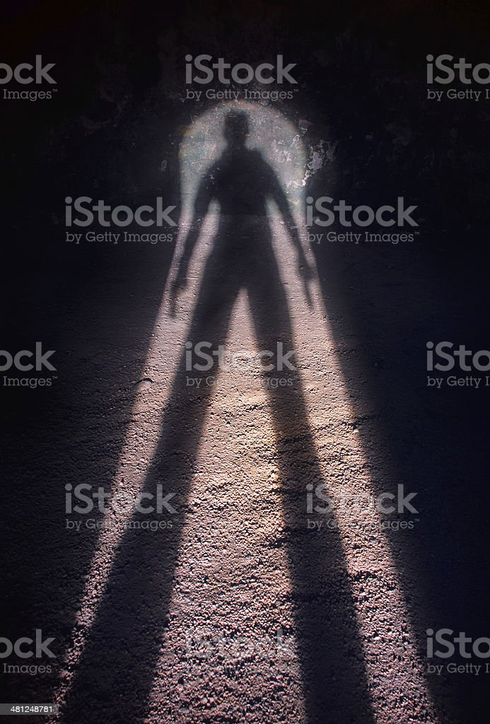 Shadow of a gunman stock photo