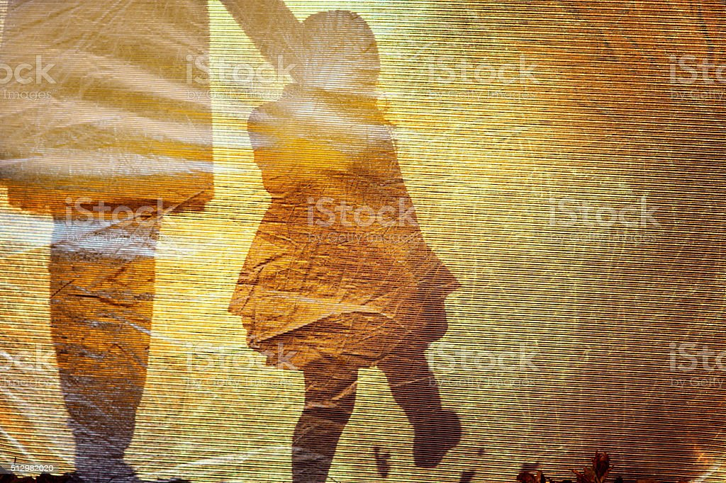 Shadow of a little girl and woman stock photo