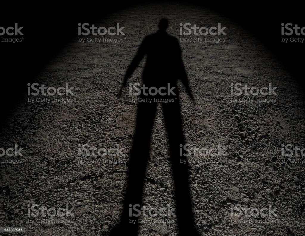 Shadow of a man on the ground texture. stock photo