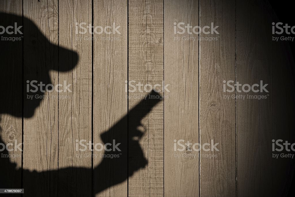 Shadow of a man with a gun, XXXL image royalty-free stock photo