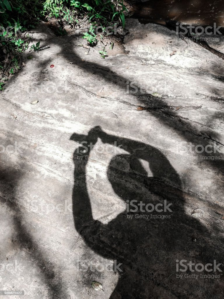 Shadow of a Photographer on a Giant Stone stock photo