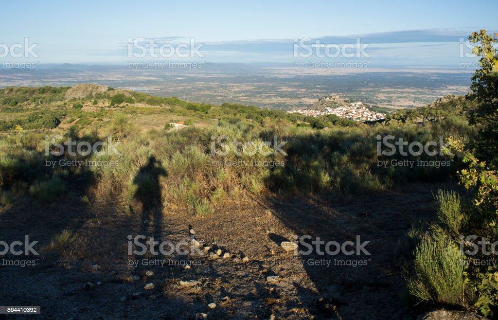 Shadow of a photographer shooting Montanchez, Extremadura stock photo