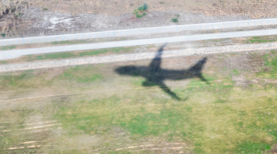 istock Shadow of a plane on grass area 1137482323