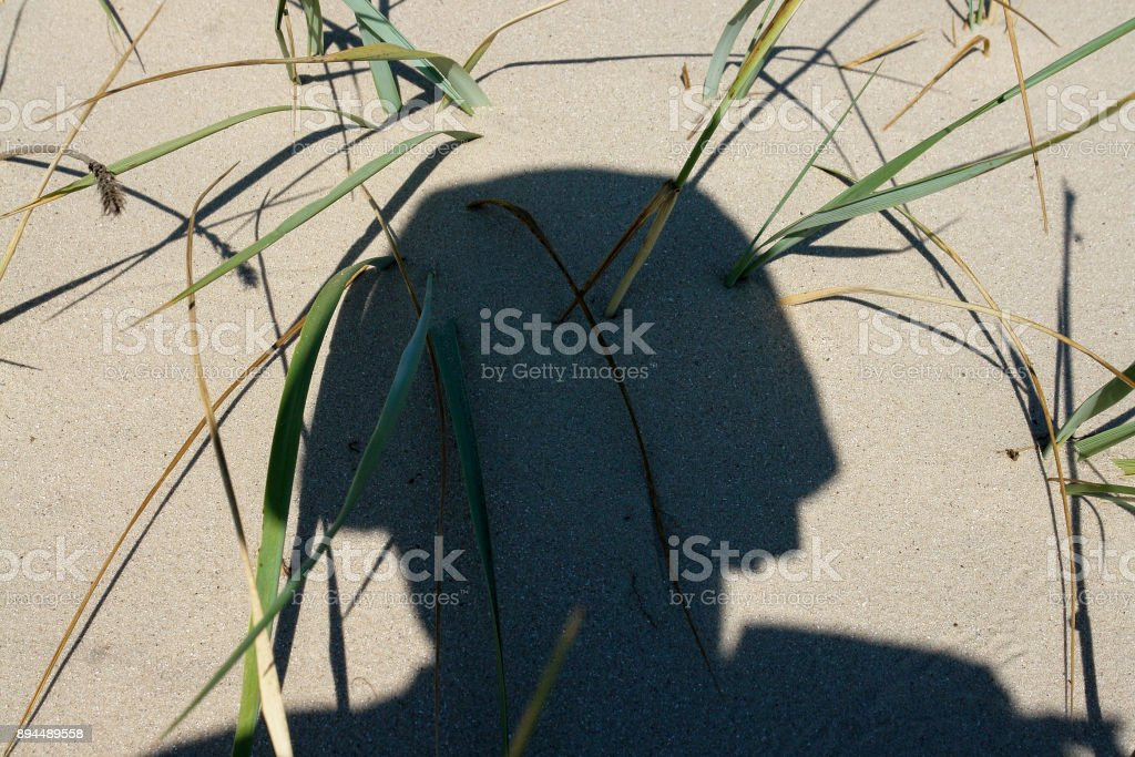 Shadow of a soldier military conflict consequences stock photo