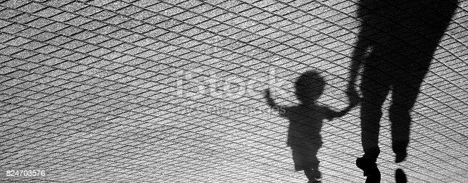 istock Shadow of a toddler and a man 824703576