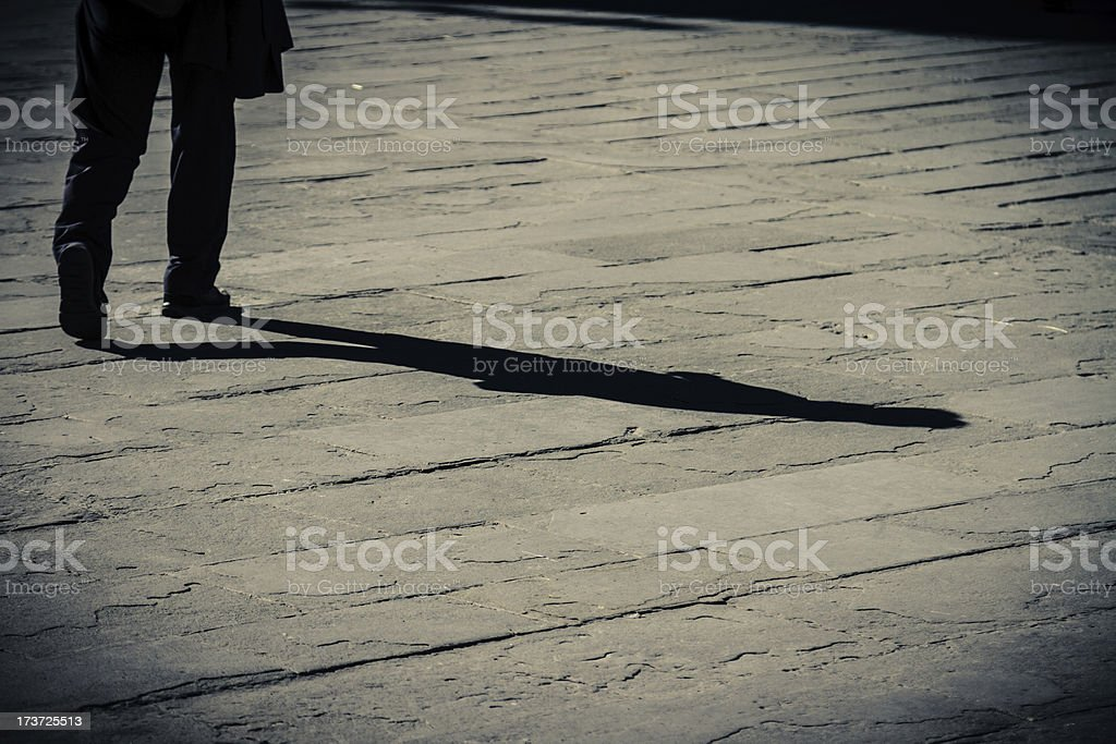 Shadow of a walking man royalty-free stock photo
