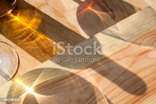 Shadow of a wine bottle with glasses over a barrel.Similar pictures from my portfolio: