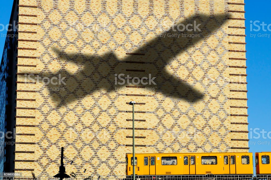Shadow of Airplane flying in Berlin, Germany Shadow of airplane Air Vehicle Stock Photo