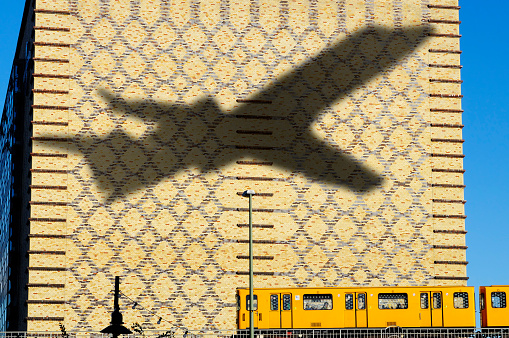 Shadow Of Airplane Flying In Berlin Germany Stock Photo - Download Image Now