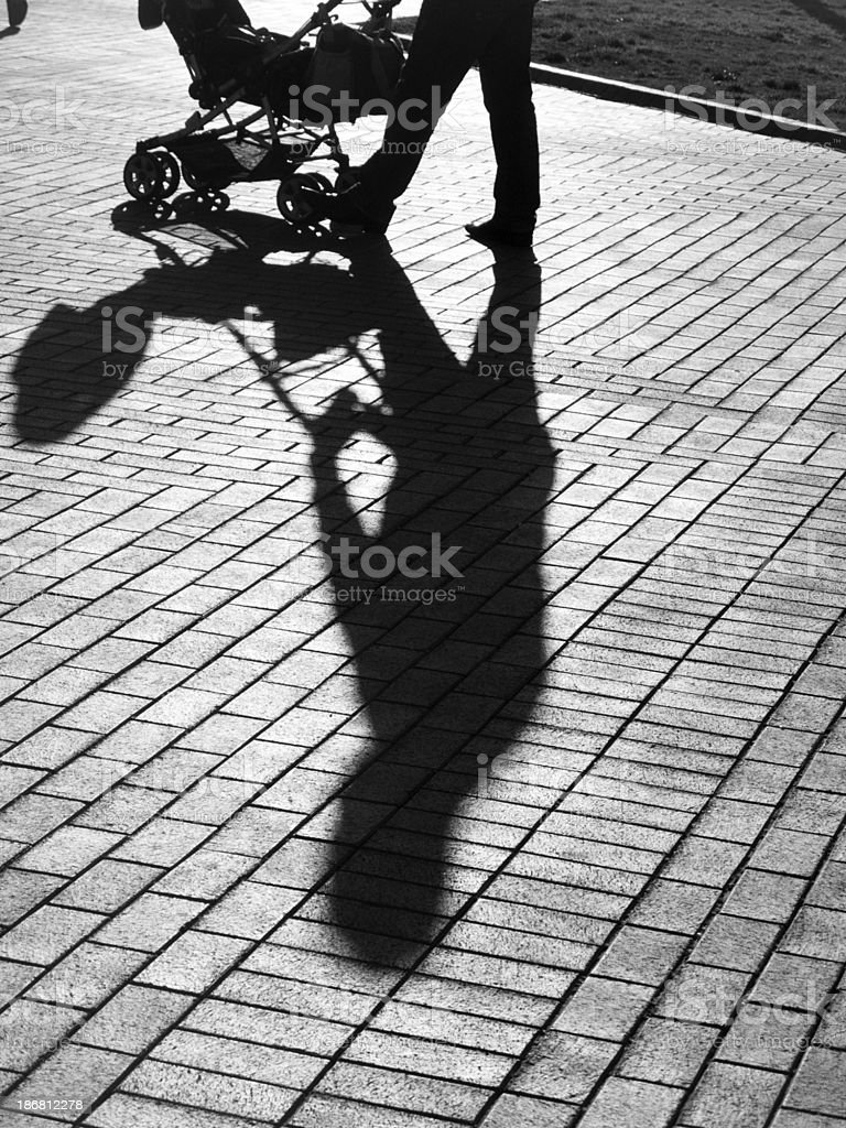 Shadow of baby carriage stock photo