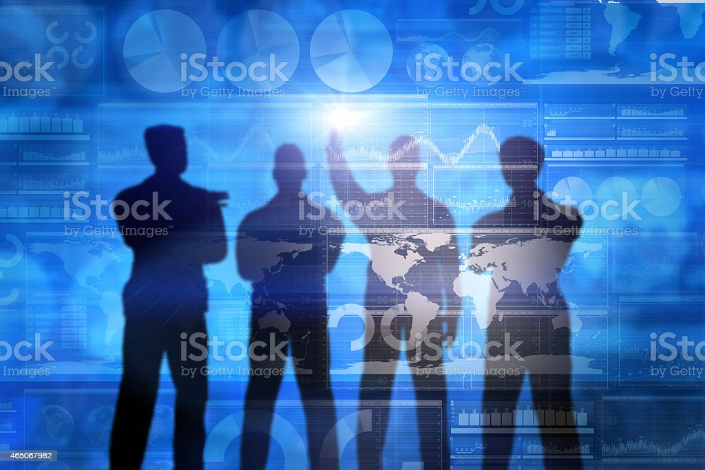 Shadow of businessmen watching finance and stock market data stock photo