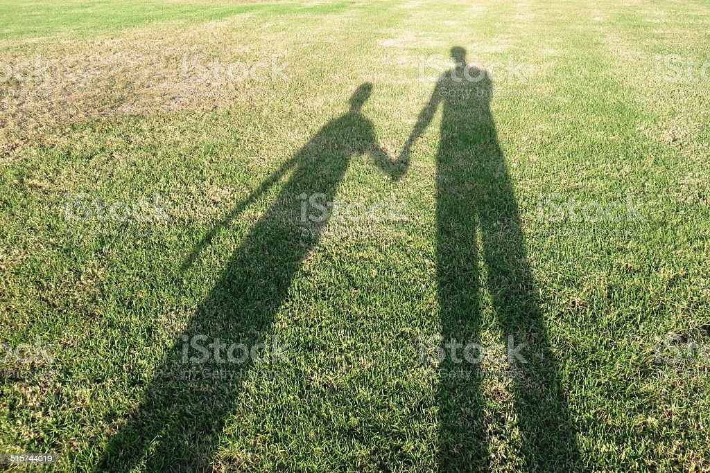 Shadow of father and son stock photo