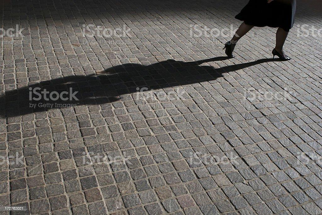 Shadow of Heels on Cobblestones royalty-free stock photo