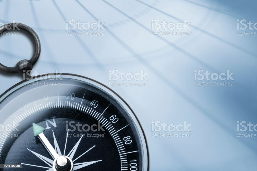 Shadow Of Latitude And Longitude Cast Across Surface And Compass stock photo