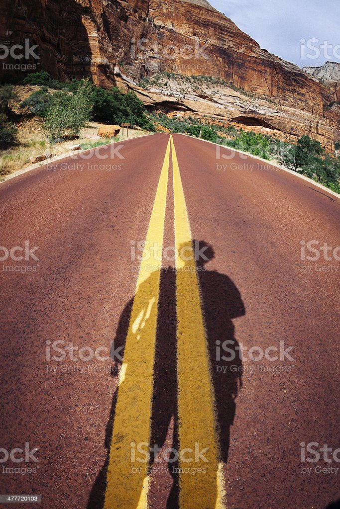 Shadow of Man on the Road royalty-free stock photo