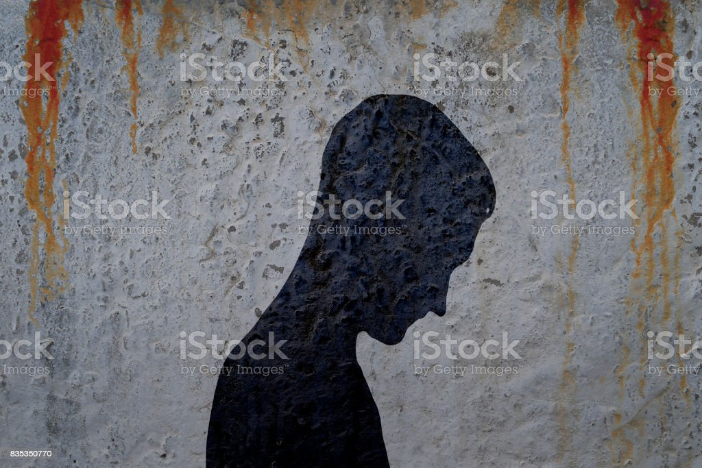 Shadow of man's body on bloody wall stock photo