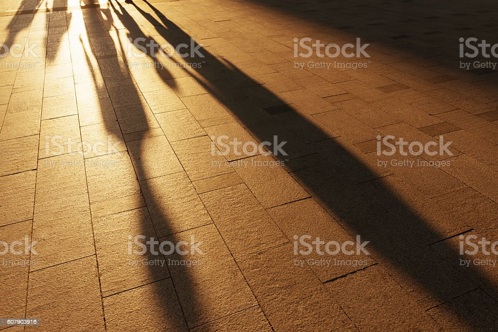 shadow of people walking together stock photo