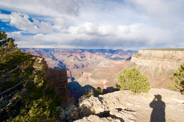Shadow of Photographer Photographing Grand Canyon stock photo