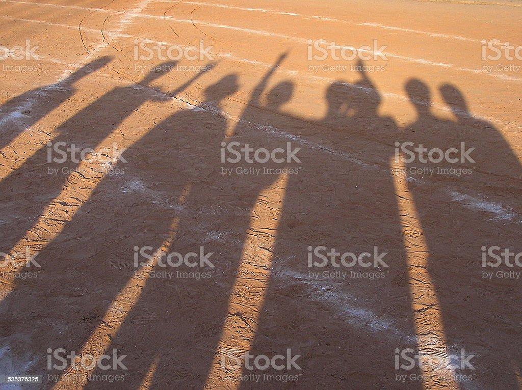 shadow of runner on racetrack stock photo