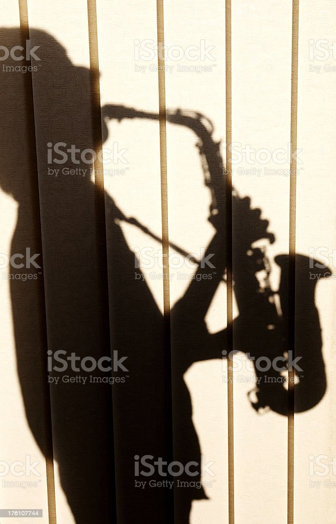 Shadow of Saxophonist royalty-free stock photo