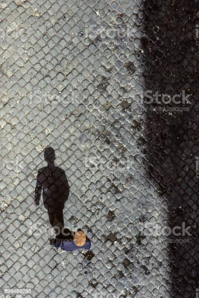 shadow of senior man on cobble stone