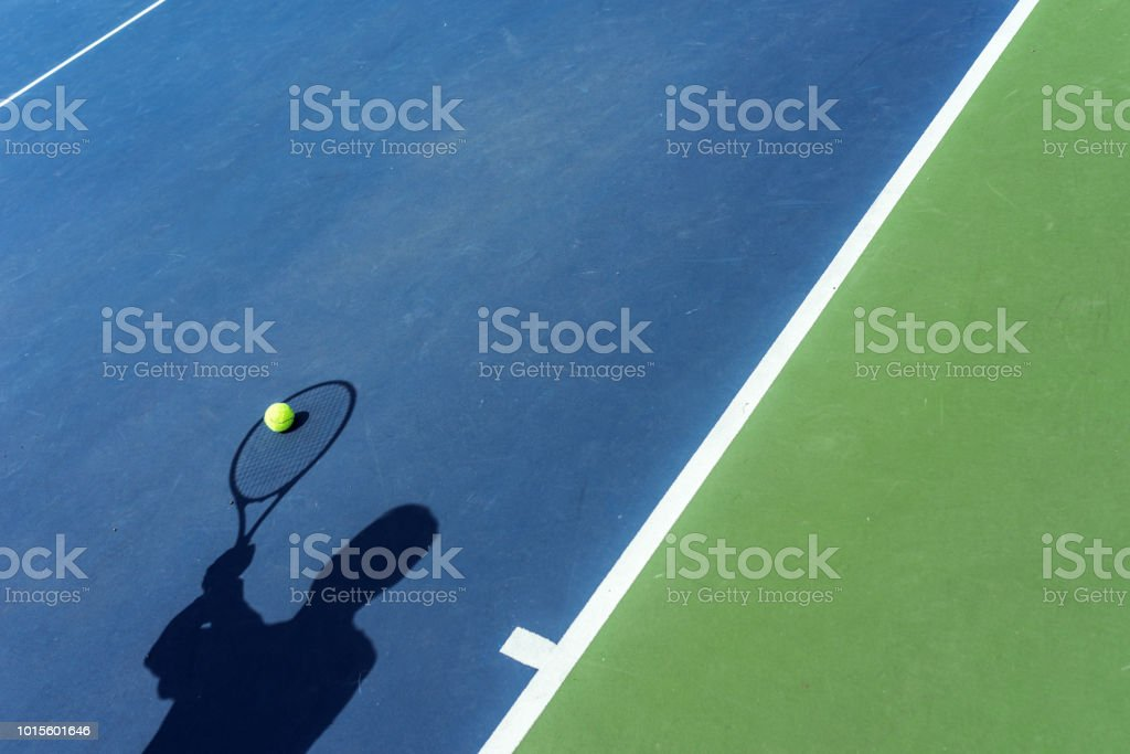 Shadow of Tennis Player catching the ball