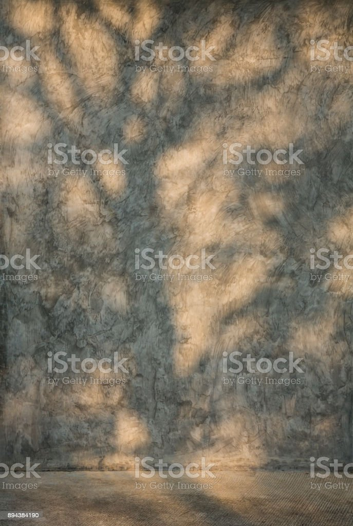 Shadow of tree branch on cement wall stock photo