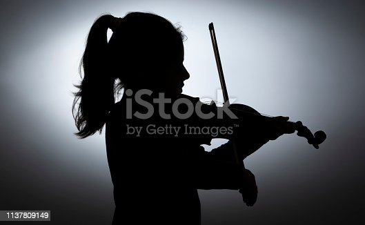 shadow of violinist girl