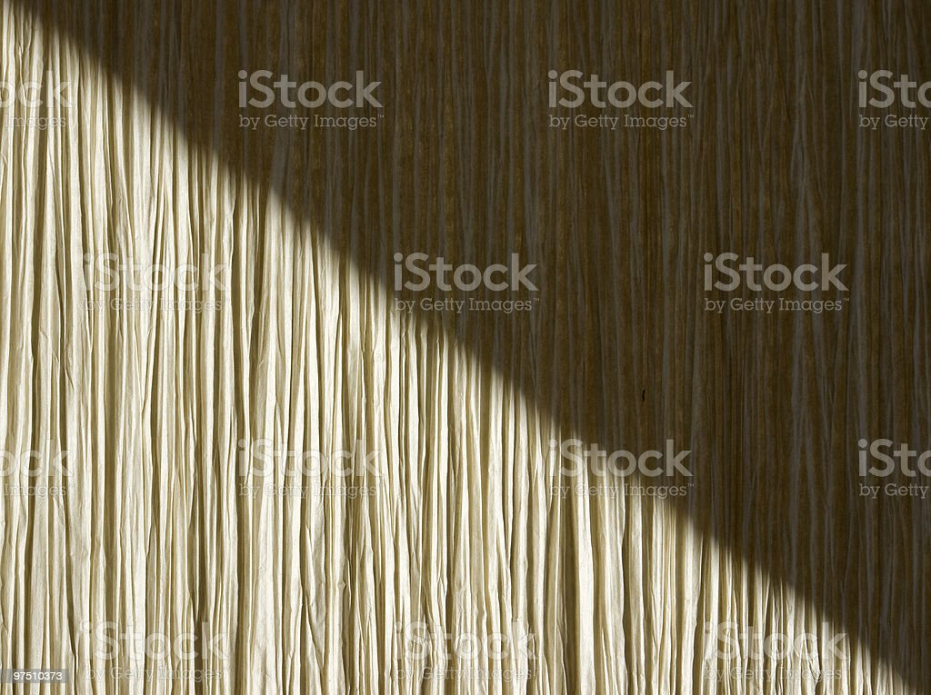 Shadow on straw background royalty-free stock photo