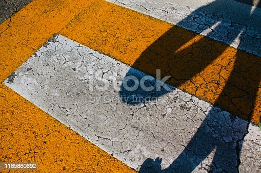 Shadow on yellow road crossing