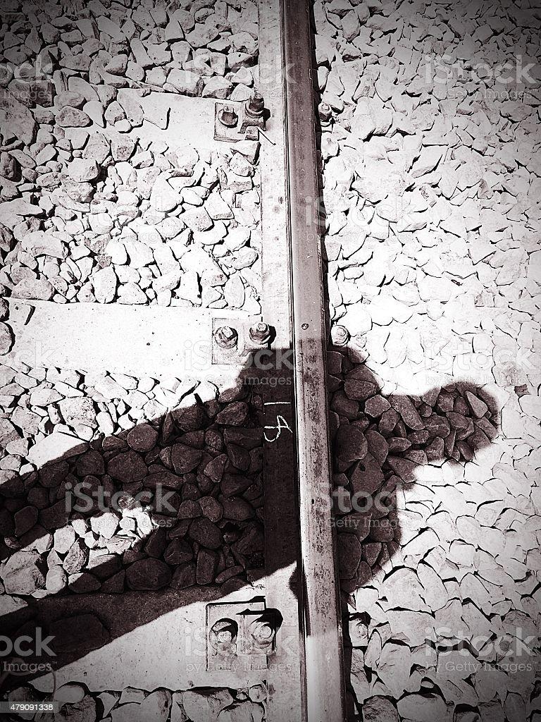 shadow on the railway stock photo