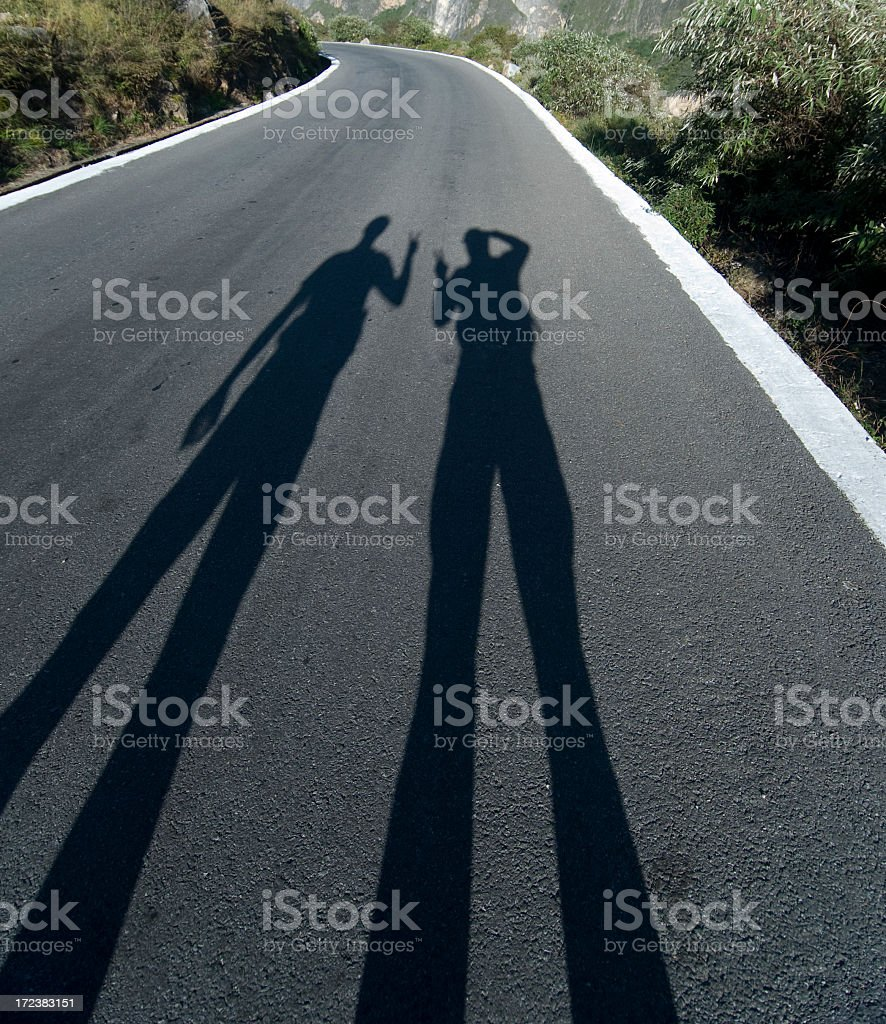 Shadow on the Road Ahead stock photo