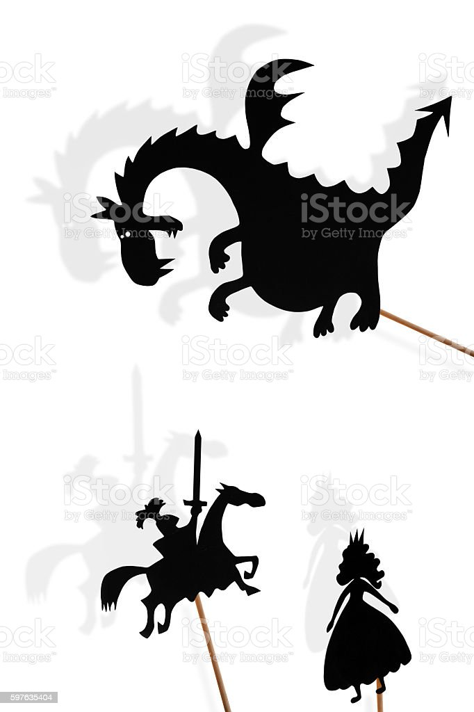 Shadow puppets of dragon, princess and knight on white background. stock photo