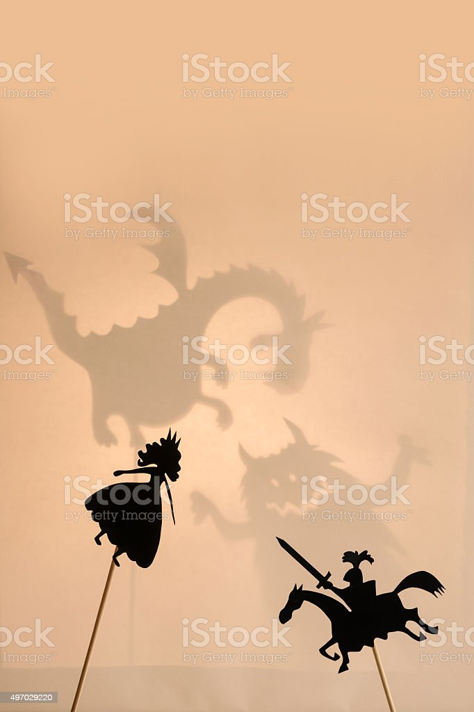 Shadow puppets of Princess and Knight, copy space background. stock photo