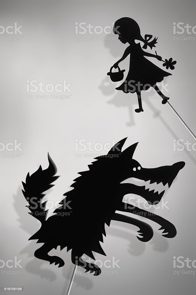 Shadow puppets of Red Riding Hood and Wolf stock photo