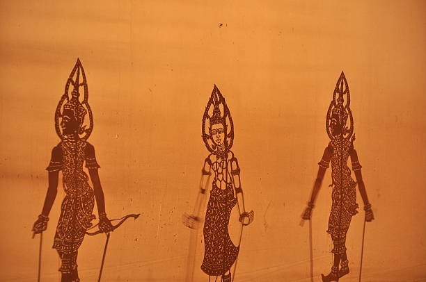 shadow puppets - wayang kulit stock photos and pictures