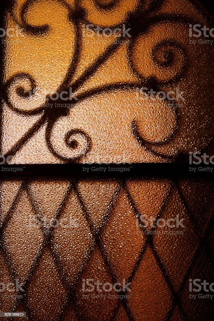 Shadow shaped metal grid on glass stock photo