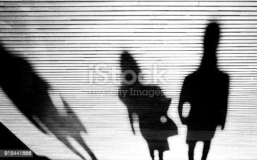 istock Shadow silhouette of people in the night 915441888
