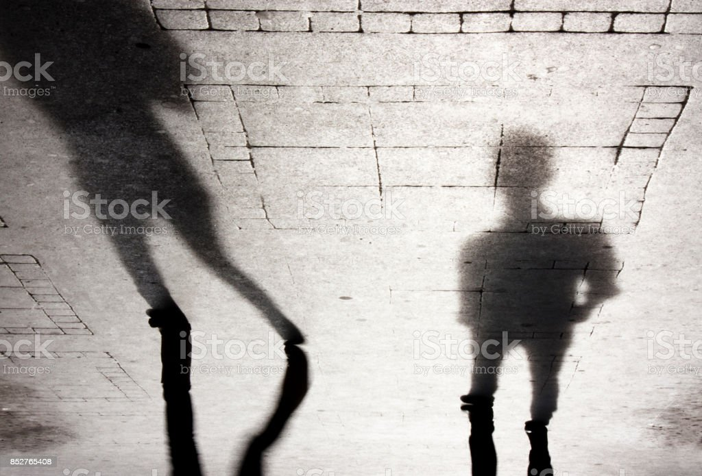 Shadow silhouette of two people stock photo