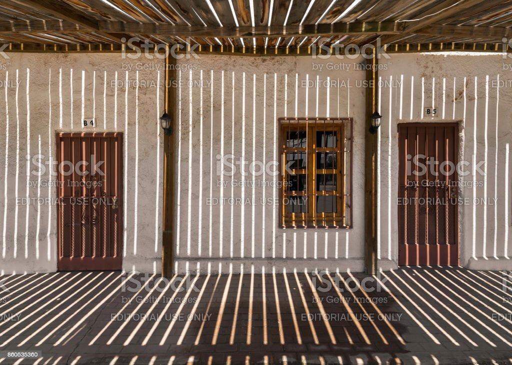 Shadow stripes on Main Street walkeay in San Elizario stock photo