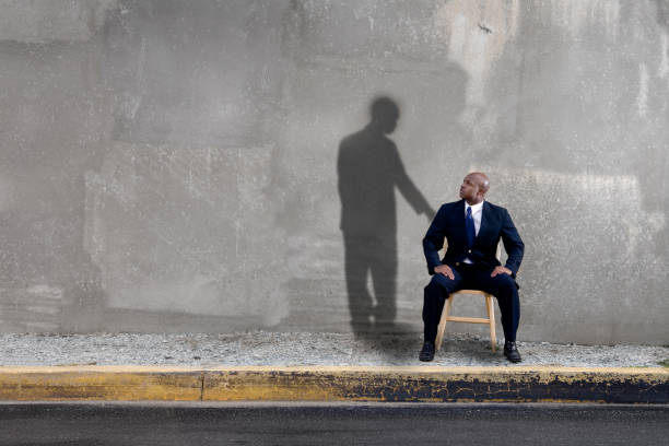 Shadow watching over man stock photo